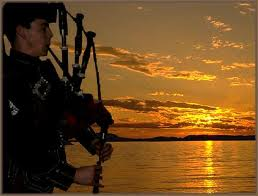 lone piper at sunset