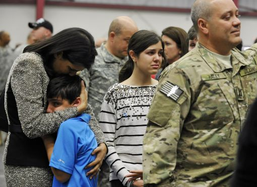 South Carolina Gov. Nikki Haley, left, comforts her son, Nalin, 10, and her daughter, Rena, 14, as her husband, Capt. Michael Haley, right, gets ready for a deployment ceremony. (Rainier Ehrhardt/Associated Press)