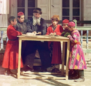 Jewish Children with their Teacher in Samarkand. Early color photograph from Russia, created by Sergei Mikhailovich Prokudin-Gorskii as part of his work to document the Russian Empire from 1909 to 1915.