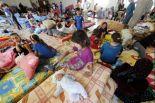 Iraqi Christian families at a community center in Erbil, June 27, 2014. (Karim Sahib/AFP/Getty Images)