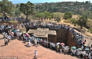 Out of stone: Bete Giyorgis, one of the 11 rock-hewn churches of Lalibela, Ehtiopia during the celebration of the Epiphany - the baptism of Jesus in the Jordan River.