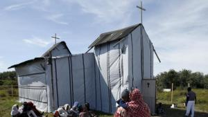 Christian migrants from Eritrea and Ethiopia attend the Sunday mass at the makeshift church in