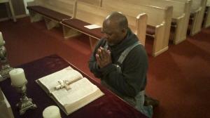 man kneeling before God