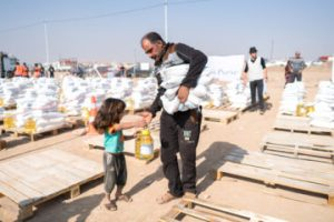 Samaritan's Purse: distributing food supplies to those fleeing the war in Mosul. [click on picture for more information]