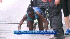 marathoner-crawls-over-finish